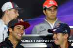(L to R): Daniel Ricciardo, Scuderia Toro Rosso and Sebastian Vettel, Red Bull Racing in the FIA Press Conference
