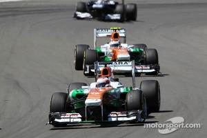 Paul di Resta, Sahara Force India VJM06 leads Adrian Sutil, Sahara Force India VJM06