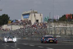 Tom Kristensen drives the Le Mans winning Audi R18 alonside the Audi A5 DTM of Mattias Ekström