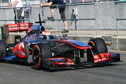 Kevin Magnussen, McLaren MP4-28 Test Driver running sensor equipment