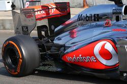 Oliver Turvey, McLaren McLaren  MP4-28 Test Driver running sensor equipment at the rear exhaust