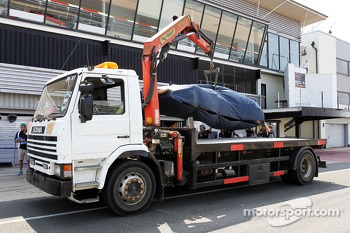 The Red Bull Racing RB9 of Daniel Ricciardo, Red Bull Racing Test Driver is recovered back to the pits on the back of a truck