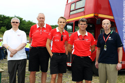 (L to R): John Booth, Marussia F1 Team Team Principal; Max Chilton, Marussia F1 Team; and Graeme Lowdon, Marussia F1 Team Chief Executive Officer with representatives from UK Trade and Investment promoting British Business in Eastern Europe