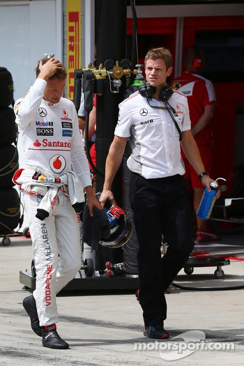 Jenson Button, McLaren with Mike Collier, Personal Trainer during qualifying