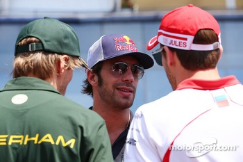 (L to R): Charles Pic, Caterham with Daniel Ricciardo, Scuderia Toro Rosso and Jules Bianchi, Marussia F1 Team on the drivers parade