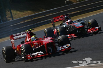 Felipe Massa, Ferrari F138 and Jenson Button, McLaren MP4-28