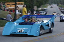 Race cars parade into Elkhart Lake for the Friday concours. #3 1972 McLaren M8F: Rick Knoop