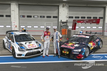 Mattias Ekström and Sébastien Ogier in front of their cars