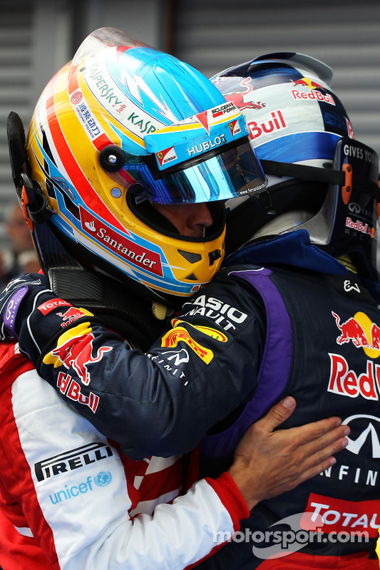 Fernando Alonso, Ferrari and race winner Sebastian Vettel, Red Bull Racing celebrate in parc ferme