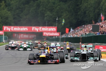 Sebastian Vettel, Red Bull Racing leads Lewis Hamilton, Mercedes AMG F1 at the start of the race