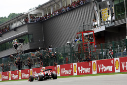 Race winner Sebastian Vettel, Red Bull Racing takes the chequered flag at the end of the race