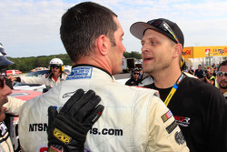 Max Papis and a crew member for Mike Skeen argue after the race