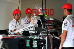 McLaren mechanics with caps celebrating 50 years of McLaren as a constructor