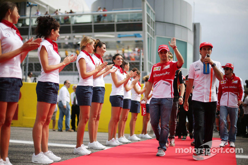 (L to R): Felipe Massa, Ferrari and Sergio Perez, McLaren on the drivers parade