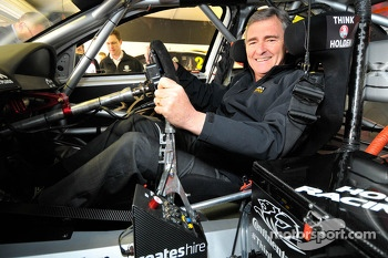 Former Victorian Premier John Brumby sits in the HRT of James Courtney