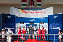 LMGTE Pro podium: class winners Bruno Senna, Frédéric Makowiecki, second place Gianmaria Bruni, Giancarlo Fisichella, third place Kamui Kobayashi, Toni Vilander