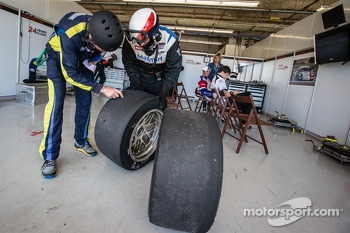 IMSA Performance Matmut team member checks tires