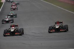Romain Grosjean, Lotus F1 Team and Kimi Raikkonen, Lotus F1 E21