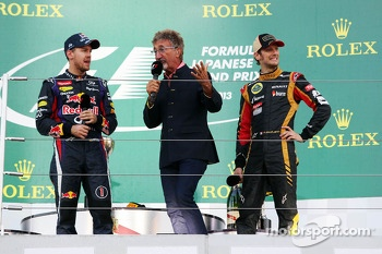 (L to R): race winner Sebastian Vettel, Red Bull Racing on the podium with Eddie Jordan, BBC Television Pundit and third placed Romain Grosjean, Lotus F1 Team