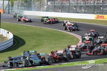 Lewis Hamilton, Mercedes AMG F1 W04 slows with a puncture after contact at the start of the race with Sebastian Vettel, Red Bull Racing RB9, as Jules Bianchi, Marussia F1 Team MR02 and Giedo van der Garde, Caterham CT03 crash in the background