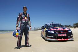 Jamie Whincup races against stunt pilot Joel Haski