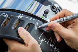 Nick Heidfeld signs autographs