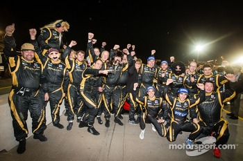 Race winners Nick Heidfeld, Neel Jani and Nicolas Prost celebrate with Rebellion Racing team members