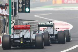Nico Rosberg, Mercedes AMG F1 W04 and Jenson Button, McLaren MP4-28