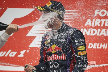 Race winner and World Champion Sebastian Vettel, Red Bull Racing celebrates with the champagne on the podium