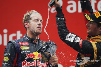 Race winner and World Champion Sebastian Vettel, Red Bull Racing celebrates on the podium with third placed Romain Grosjean, Lotus F1 Team
