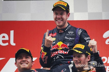Podium: race winner and 2013 world champion Sebastian Vettel, second place Nico Rosberg, third place Romain Grosjean