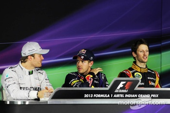 The FIA Press Conference: Nico Rosberg, Mercedes AMG F1, second; Sebastian Vettel, Red Bull Racing, race winner and World Champion; Romain Grosjean, Lotus F1 Team, third