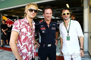 Christian Horner, Red Bull Racing Team Principal, with Dominic Howard, Muse, and Matthew Bellamy, Muse (Right)