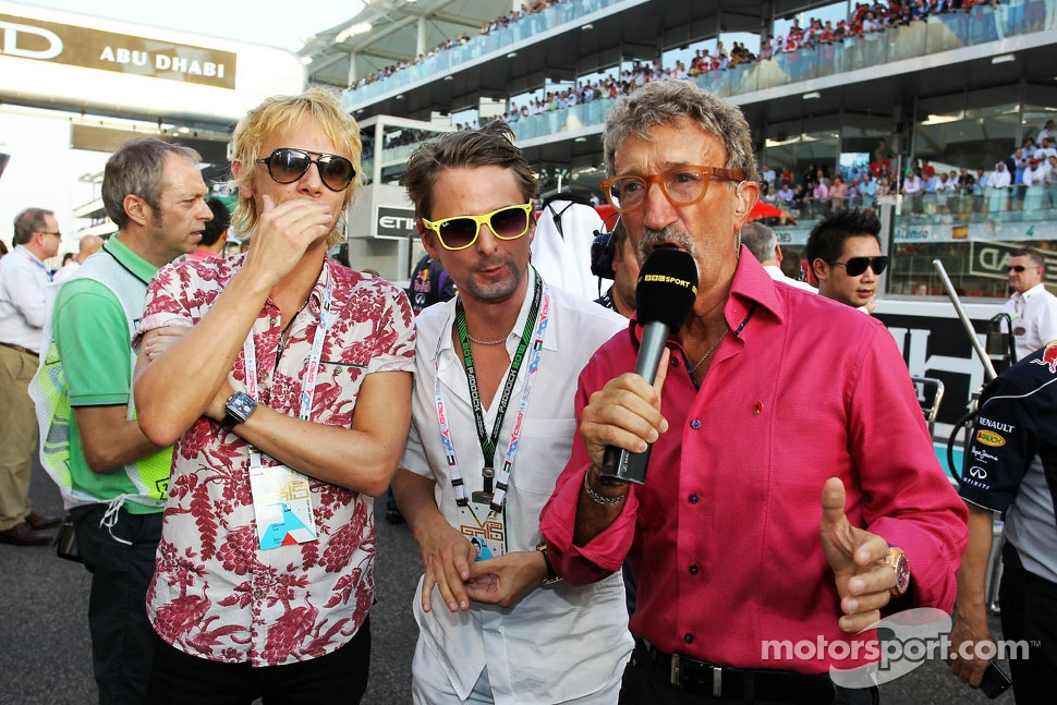 Eddie Jordan, BBC Television Pundit with Dominic Howard, Muse, and Matthew Bellamy, Muse, on the grid