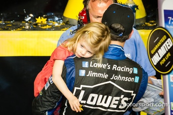 Championship victory lane: NASCAR Sprint Cup Series 2013 champion 2013 Jimmie Johnson, Hendrick Motorsports Chevrolet celebrates with daughter
