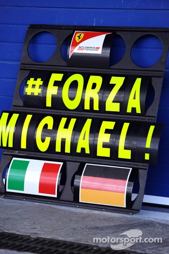A Ferrari pit board showing support for Michael Schumacher