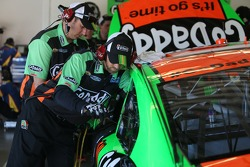 Danica Patrick, Stewart-Haas Racing Chevrolet team members work on the car
