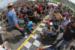 Fans sign the start finish line