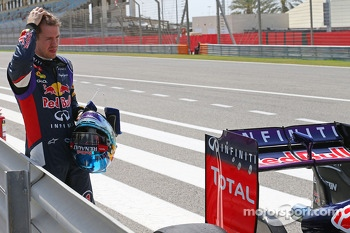 Sebastian Vettel, Red Bull Racing RB10 stops at the pit lane exit