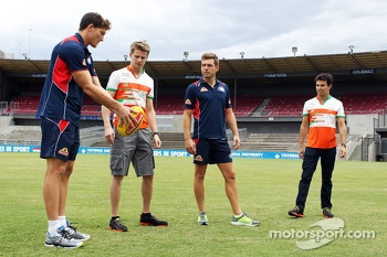 Nico Hulkenberg, Sahara Force India F1, and team mate Sergio Perez, Sahara Force India F1, receive an Aussie Rules lession from Will Minson, Western Bulldogs Australian Rules Footballer, and Shaun Higgins, Western Bulldogs Australian Rules Footballer, at
