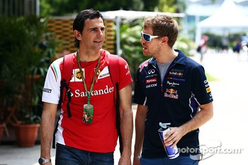 (L to R): Pedro De La Rosa, Ferrari Development Driver with Sebastian Vettel, Red Bull Racing