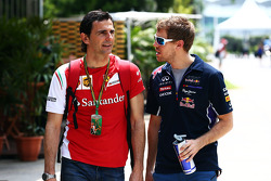 F1: (L to R): Pedro De La Rosa, Ferrari Development Driver with Sebastian Vettel, Red Bull Racing