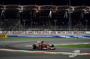 Kimi Raikkonen, Ferrari F14-T passes the Michael Schumacher corner where a message of support is displayed on the armco