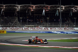 Kimi Raikkonen, Ferrari F14-T passes the Michael Schumacher corner where a message of support is displayed on the armco