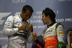 Lewis Hamilton, Mercedes AMG F1 and Sergio Perez, Sahara Force India F1
