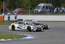 battle between Marco Wittmann, BMW Team RMG, BMW M4 DTM, and Edoardo Mortara, Audi Sport Team Abt, Audi RS 5 DTM, Portrait
