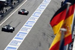 Nico Rosberg, Mercedes AMG F1 W05 leads Lewis Hamilton, Mercedes AMG F1 W05 out of the pits