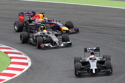 Jenson Button, McLaren MP4-29 leads Esteban Gutierrez, Sauber C33 and Sebastian Vettel, Red Bull Racing RB10