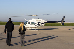 Kurt Busch and girlfriend Patricia Driscoll walk to the helicopter that will fly them to IMS