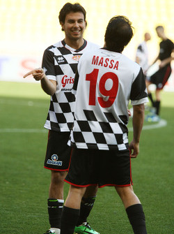 (L to R): Sergio Perez, Sahara Force India F1 and Felipe Massa, Williams at the charity football match